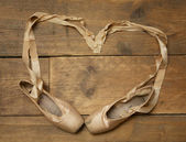Pair of Ballet Shoes on Wooden Floor — Stock Photo