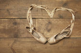 Two Ballet Shoes on Wooden Floor — Stock Photo