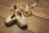 Ballet Shoes on Wooden Floor — Stock Photo