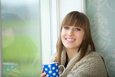 Beautiful Young Woman Smiling with Cup of Tea — Stock Photo
