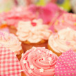 Cupcakes decorated with Frosting and Sprinkles - Stock Photo