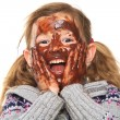 Little Girl with Chocolate Covered Face — Stock Photo #23615471