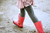 Little Girl Walking Outdoors with Red Boots — Stock Photo
