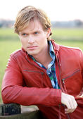 Male Fashion Model in Red Jacket — Stock Photo