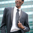 Portrait of a happy african american businessman smiling outside — Stock Photo