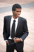 Portrait of a handsome young african american businessman smiling outside — Stock Photo