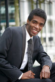 Handsome young african american businessman smiling — Stock Photo