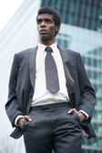 Portrait of a handsome young african american businessman outdoors — Stock Photo