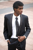 Portrait of a handsome african american fashion model in black suit — Stock Photo