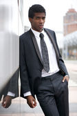 Portrait of a handsome young african american man standing in the city — Stock Photo