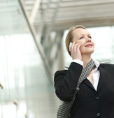 Portrait of a business woman talking on the phone outdoors — Stock Photo