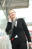 Portrait of a professional business woman on the phone outside — Stock Photo