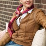 Beautiful mature woman smiling outdoors — Stock Photo #24437835