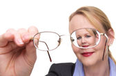 Portrait of a businesswoman looking through her glasses — Stock Photo