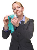 Portrait of a businesswoman cleaning her glasses — Stock Photo