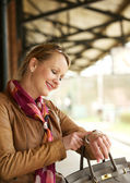 Beautiful woman pointing to her watch outdoors — Stock Photo