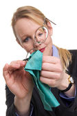Portrait of a woman cleaning her glasses — Stock Photo