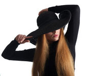 Close up portrait of a female fashion model posing in black hat — Foto de Stock