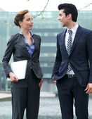 Business colleagues in discussion outdoors — Stock Photo