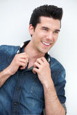 Portrait of a happy young man smiling with headphones — Stock Photo