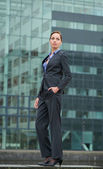 Business woman standing outside the office — Stock Photo