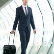 Young businessman walking in subway station with bag — Stock Photo