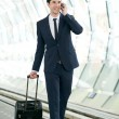 Businessman talking on mobile phone at metro station — Stock Photo