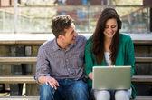 University students working on laptop outdoors — Stock Photo
