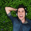Smiling handsome man with headphones outdoors — Stock Photo
