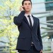 Businessman talking on cellphone outdoors — Stock Photo #25397663