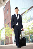 Businessman traveling with bag — Stock Photo
