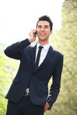 Portrait of a business man talking on the phone — Stock Photo
