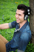 Happy young man relaxing outdoors — Stock Photo