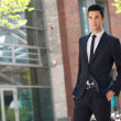 Handsome businessman walking to work - Stock Photo