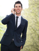 Confident young businessman on the phone — Stock Photo