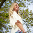 Beautiful hippie girl dancing under a tree — Stock Photo #25801365