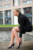 Portrait of a business woman sitting outside — Stock Photo