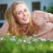 Portrait of a happy young woman relaxing outdoors — Stock Photo