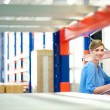 Businesswoman  controlling inventory in a warehouse — Stock Photo