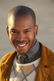 Portrait of an attractive young african american man smiling outdoors — Stock Photo