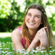 Beautiful young woman smiling outdoors — Stock Photo