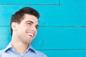 Good looking young man smiling and looking away — Stock Photo