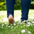 Woman walking in the park barefoot — Stock Photo