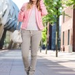 Attractive young lady walking in the city — Stock Photo #27358377