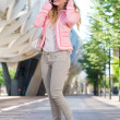 Young female talking on cellphone outdoors — Stock Photo #27358455