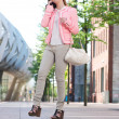 Walking woman talking on mobile phone in the city — Stock Photo