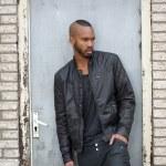 Attractive young black man standing in door way — Stock Photo #27714259