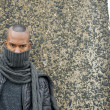 Black man with scarf covering face outdoors — Stock Photo