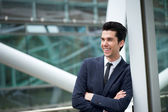 Young businessman smiling outdoors — Stock Photo