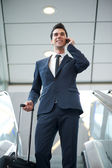 Young businessman traveling with bag and phone — Stock Photo